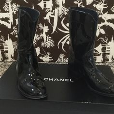 Chanel patent leather bootie Great looking Chanel bootieblack patent leather with the big cc logo on the back. These look great with skirts Or jeans tucked in✨ CHANEL Shoes Ankle Boots & Booties