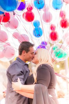 Disneyland engagement photo session. Mickey balloons. A&C Photography. Adam and Claudia Photography.