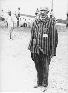 A Prisoner in Dachau forced to stand without moving for hours as a punishment.