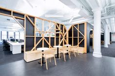 The Quartz office occupies a rectangular space in a historic cast-iron building in the Flatiron District. Launched in 2012 and owned by Atlantic Media, Quartz runs a popular website focused on the global economy.