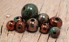 9 Mykonos Greek Ceramic Round Raku Beads Assortment - Dark Bronze Raku - Big Hole Beads Rustic Organic - 23mm 18mm 12mm. $23.48, via Etsy.