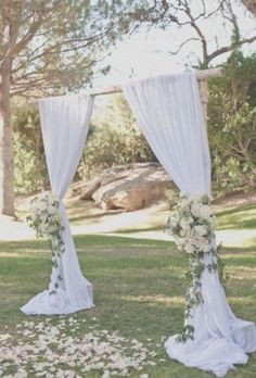 Ceremony aisle wedding arches don't always have to be over the top! Here a simple arch is simply draped and two pretty flower bundles adorn the tie-backs. Wedding Canopy, Wedding Ceremony Backdrop, Beach Ceremony, Wedding Arches, Simple Wedding Arch, Church Wedding Flowers, Wedding Ideas, Outdoor Wedding Altars, Outside Wedding