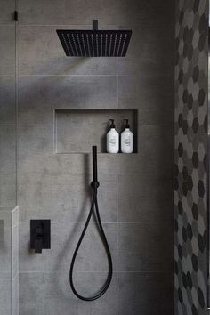 In this modern bathroom, the shower has a matte black rainfall shower head and a hand held shower head, as well as a tiled built-in shelf. - In this modern bathroom, the shower has a matte black rainfall shower head and a. Bad Inspiration, Bathroom Inspiration, Bathroom Ideas, Bathroom Renovations, Bathroom Organization, Bath Ideas, Bathroom Storage, Bathroom Layout, Bathroom Shelves
