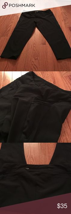 Lucy Capri leggings Black running leggings (capri length). Tie at waist. Back pocket. Two side pockets. Compressive to support higher impact activity. Lightly used - good condition! Lucy Pants Capris