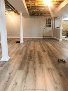 Harvest Oak Rigid Core Vinyl Flooring, Sherwin Williams Lullabye paint and white lally columns Blue Grey Walls, Grey Wall Color, Oak Color, Blogger Home, Vinyl Plank Flooring, Floor Colors, Basement Renovations, Flooring Options, Home Projects