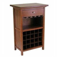 """Winsome Regalia 20 Bottle Wine Cabinet by Winsome. $156.13. Color: Walnut. Size: 26.6""""l x 15.7""""w x 40.4""""h. Set down your glass of Chablis on this smooth walnut bar.. Winsome Regalia 20 Bottle Wine Cabinet... makes hospitality a natural! Whether it's a big party or a couple of friends sharing an evening... this Wine Cabinet has room for plenty of selection, and all the serving accessories you need! Features you'll appreciate: Glass racks; Made of solid beechwood; Holds 20 bottl..."""