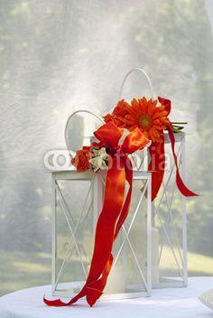 Two whites lanterns with orange bow