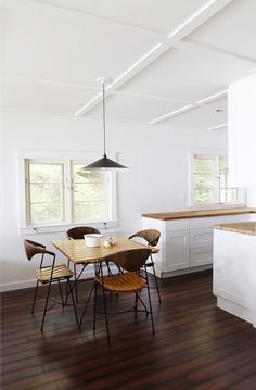 #white #cottage #dining_room  with #dark_floor and #white_walls