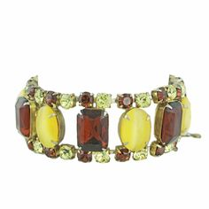 Need vintage jewels?  We got you!. http://hautebaublevintage.com/vintage-root-beer-and-yellow-jeweled-bracelet/ #vintagejewelry