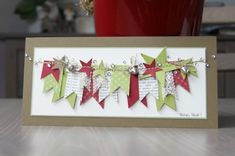 punches & banners sewn; banner flags of lace & vintage paper; jingle bells & sprinkle rhinestones