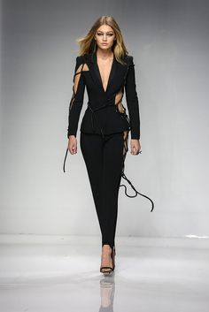 Suits just got the SS16 Couture Fashion Week seal of approval by Gigi Hadid and Versace.