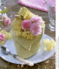 napkin folded into envelope/basket - add flowers or greenery