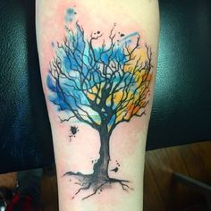 Watercolor Painted Tree. Another bare branched tree on the list. If you love bare branched tree tattoos, consider this one for your next tree tattoo.