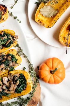 Delicata squash perfectly roasted and stuffed with coconut creamed kale and hearty mushrooms. A simple and delicious side dish or main entree, a healthy easy way to eat your veggies! #VeganRecipe #SideDish #DelicataSquash