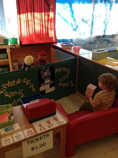 Movie theater meets puppet theater - tickets, popcorn tubs, seating, etc.