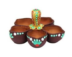 Set of  5  diwali diyas with various variations.