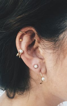 PERFECT ear party vibes!! Loving all the modern minimal pearl accents and ear cuffs! via @bingbangnyc. Click through to shop!