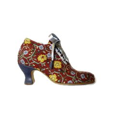Tapestry shoe produced on commission through Fine Cell Work commission. Fine Cell Work trains prisoners in paid, skilled, creative needlework undertaken in the long hours spent in their cells to foster hope, discipline and self-esteem. The work is of a superb quality as prisoners are taught and supported by volunteers from the Embroiderers and Quilters Guild. Prisoners are paid for their work, which is then sold around the world