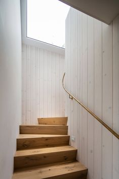 Renovated by New York* studio T W Ryan Architecture, the black timber surf house is located on a sandy lot in Ditch Plains – a famous surf spot in Montauk, which is a village at the east end of the Long Island peninsula.