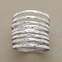 EIGHT DAYS A WEEK RING SET--Hammered sterling silver bands group together or stack with other rings. Set of 8