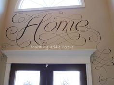 Great decorating idea for high, 2-story foyer wall! I hand painted the word HOME and added large scrolls and flourishes in client's 2-story foyer.