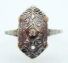 Vintage 14 Karat White and Yellow Gold Ring with Genuine Natural Diamonds. Dates between 1900-1910.