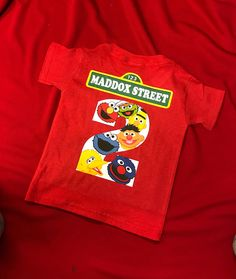 Elmo Birthday shirt with number This can be put on the front or the back of the shirt. Please include in the note to seller section the number to place on shirt. you can also include Elmo face on the front or back for an additional $1.00