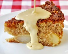 Pear and Almond Cake with Creme Anglaise - A wonderfully moist and nutty flavored cake with sweet pears baked right in and served with warn Creme Anglaise custard. A superb Autumn comfort food dessert.
