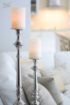 The intricate carving on these flameless (battery-operated) candles emulate the twisted and organic form of the piece of driftwood. They also create a visual contrast against the metal surface of the pillar holders.