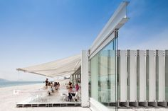 À margem Bar, Ricardo Vaz and Joao Pedro Falcao de Campos built a pavilion on the esplanade along the River Tejo with little more than white-painted, screwed-together steel sections and glass.