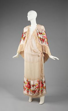 This negligee incorporates a public look into an intimate garment. The materials used are extremely delicate and sheer, making it not only feminine but extremely seductive. The inclusion of the Spanish-style fringed silk shawl is significant, for it was all the rage in the early 1920s, making this negligee trend appropriate.