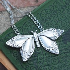 This beautiful butterfly pendant takes flight as a uniquely wearable cutlery jewelry. Inspired from heirloom silverware patterns from the late 1800s, it is created by combining parts of several vintage spoons. Available at Whole Soul Jewelry. $60.00 http://www.wholesouljewelry.com/silver-spoon-butterfly-pendant-necklace-cutlery-jewelry/