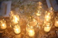 Mason jars...you can use with just candle, a little sand, saw these with votive glass inside