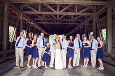 outdoor wedding: no jacket for the groomsmen; groom distinguished by vest; bridesmaids in short dresses and no heels; bride in light, fitted dress and dressy sandals