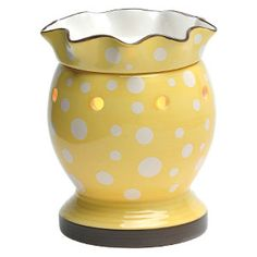 Dotty Full-Size Scentsy Warmer PREMIUM.  Dotty's sunny yellow glossy finish and white polka dots are bright and cheerful. The ruffled warmer dish adds a frilly accent like the trumpet on a daffodil.  Looks great in an Easter basket, or any room with retro decor.  On Scentsy clearance rack for $28.00.  Click picture to order.