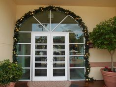 Miller Lights decorates many hotels, town centers, restaurants, Housing developments and resorts for the holidays.  Adding wreaths above doors and windows is always a nice touch. .  Click on pin to find out about our services.