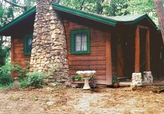 Rustic cabin with classic forest green used for the trim. ~ This would suit me just fine.