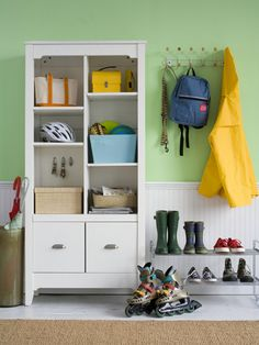 A busy family requires structured storage with room for everything from sports equipment to mail. Use baskets and bins to corral papers, toys and balls in an open cabinet