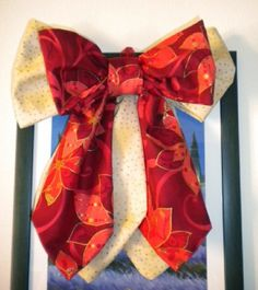 Double cotton bow coloured cream with little stars and red with red and gold poinsettia