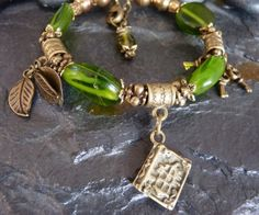 Bronze and Green Glass Bracelet with Book, Leaf and Key Charms