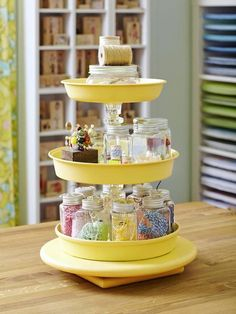 DIY Caddy made with a spray painted lazy Susan, cake pans and candle sticks. Great storage for jars, twines, spools, washi tapes, etc.