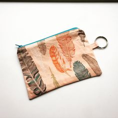 I was placing a fabric order this morning, and I kept seeing all this awesome material. It inspired me to try this little change purse. I prefer to think of it has inspiration and not distraction.  #fabric #work  #sew #sewing #bohochic #feathers #handmade #oklahoma #okc #inspired #boutique #oklahomamade #coinpurse #accessory