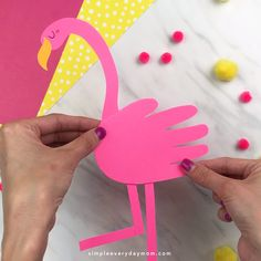 flamingo paper craft is an easy and fun summer activity for kids. It's a simple DIY that both boys and girls will love making plus it comes with a free printable template. Mom, Dad, Grandma and Grandpa will love getting this sweet handprint craft! Diy Crafts For Girls, Summer Crafts For Kids, Fun Diy Crafts, Paper Crafts For Kids, Art For Kids, Arts And Crafts, Kids Diy, Diy Paper, Card Crafts