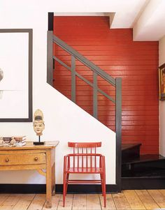 Red accent wall - House Beautiful Magazine love the wood too. Orange Walls, Red Walls, White Walls, Bright Walls, Black Walls, Best Paint Colors, Wall Colors, Paint Colours, Interior Walls