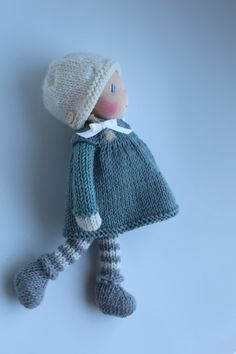 Meet little Emily!  Emily is a little Waldorf knitted doll made in The Netherlands from all natural materials: Swiss eco cotton knit doll fabric, clean carded wool, Supersoft baby merino/cashmere yarn and a knitted curly mohair wig. Her face is hand embroidered and her cheeks are blushed with Stockmar beeswax crayon.  She is about 8 inch (20 cm) tall.  This sweet little doll will become your very best friend.  Emilys body is handknitted from supersoft baby merino/cashmere yarn in the colours…
