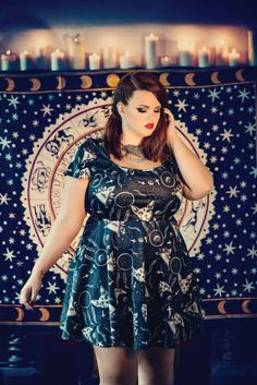 Ready for magical party night? This lovely and flattering short sleeve skater style dress is funky and in-style. The dress has all over print of sphynx cats, third eyes, crosses and feather dream catc