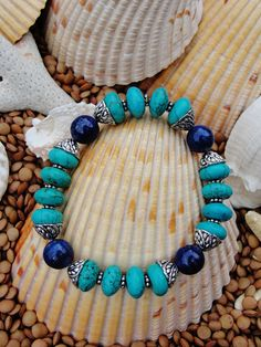 Beautiful Lapis Lazuli 8mm rounds and Turquoise 8mm rondelles make up this striking stretch bracelet. Decorative silver bead caps and silver