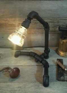 Industrial machine art steampunk pipe lamp with glass wire insulator, steampunk light