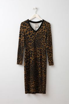 """Jael Leopard Print Jersey Dress itted leopard printed jersey dress with an invisible zip at back for making a slit. This is a great jersey dress. I find it's a more discreet than I guess a proper leopard print. The neck line is also not too low and with long sleeves, it makes the dress less """"sexy"""" even though it's definitely on the sexy side."""