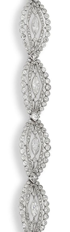 A belle époque diamond bracelet, circa 1910  Composed of a series of openwork elliptical links millegrain-set with old brilliant, rose, and marquise-cut diamonds, diamonds approximately 10.00 carats total, numbered, length 17.8cm